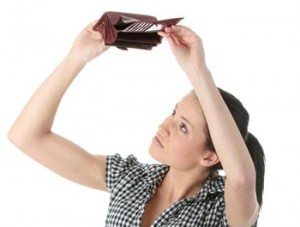 woman-looking-for-money-in-wallet-300x227